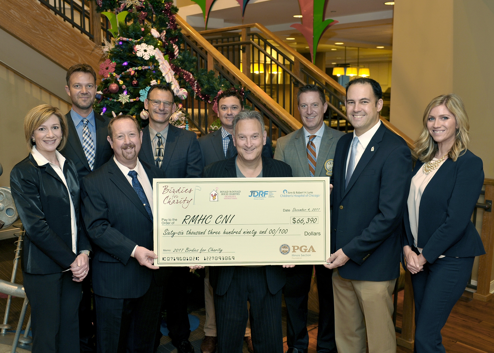 Illinois PGA Professionals and Staff present check to RMHC CNI