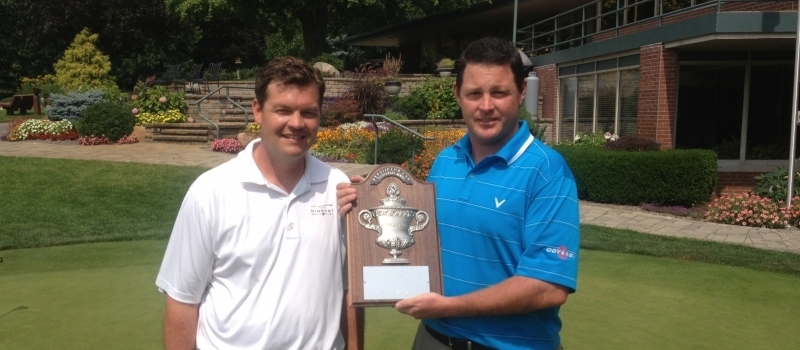 Champion Brett Melton with Club Car Sales Representative JJ Spreitzer
