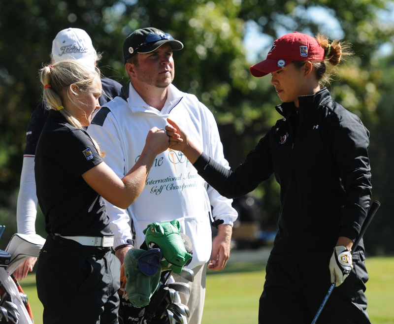 Brooke Henderson (left) and Taylor Kim (right) at the 2011 Spirit International