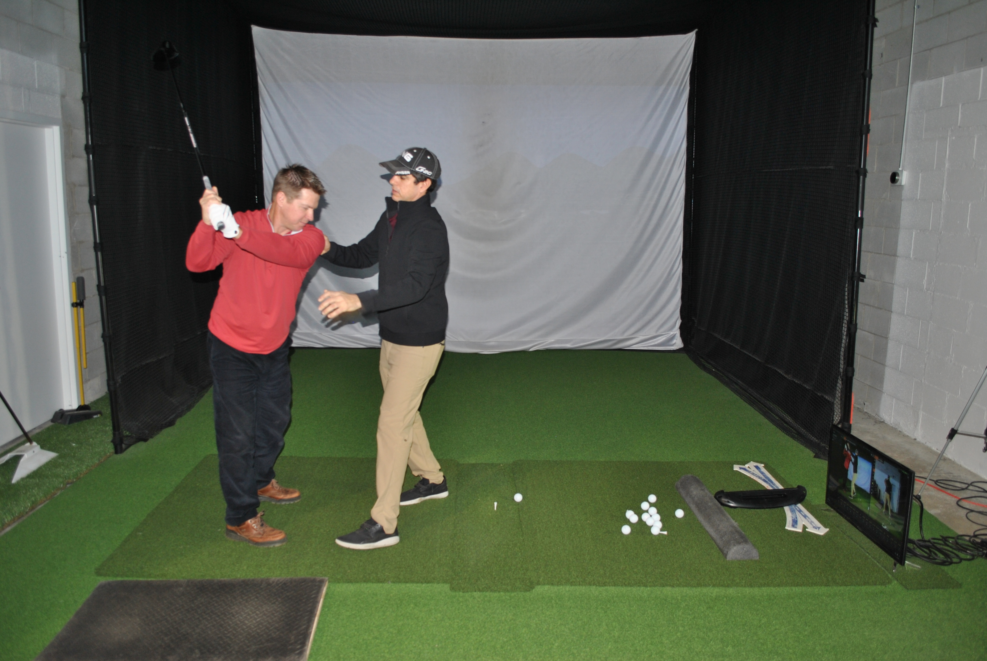 Louis Sauer, Illinois PGA Teacher of the Year, works with a student at his LS Golf studio in Northbrook