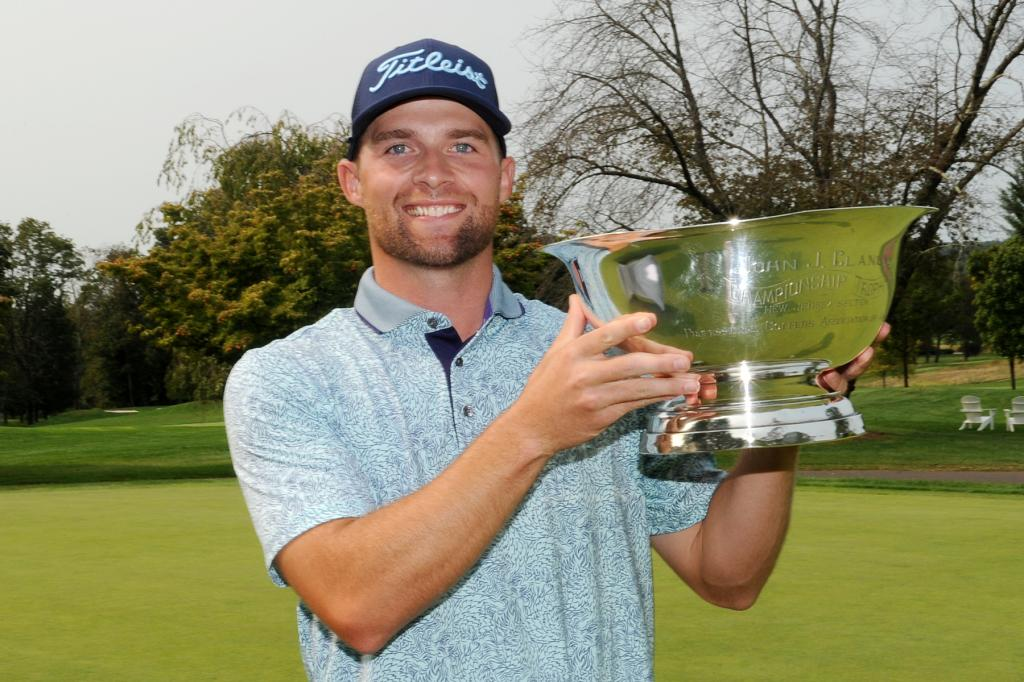 Danny Lewis holds the NJPGA Professional Championship Trophy after his historic win